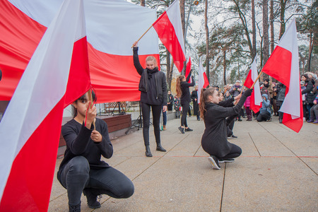 Jozefow, Poland - November 11, 2016: Young people with white red flags during the celebration of Independence Day in Jozefow Editorial