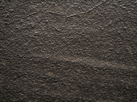 Background. The wall of silver, uneven stone
