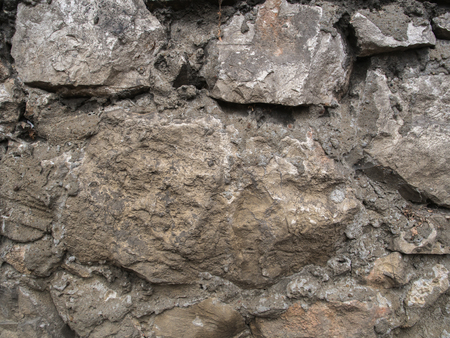 Background. The wall of gray, uneven stone Banco de Imagens