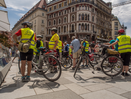 Vienna, Austria - May 23, 2017: Bikers on a street of Vienna, near the St. Stephens Cathedral on the Stephansplatz