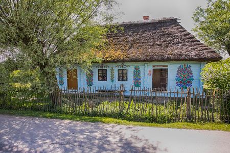Zalipie, Poland - May  20,  2017: Colourful  log house in the yard of Felicia Curylowa in the village Zalipie in Malopolska, spring  time