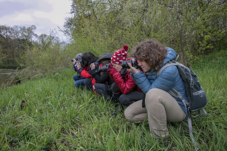 Otwock, Poland - April 29, 2017: People interested in photography take pictures during the spring outdoors photo session