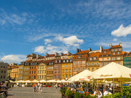 Warsaw, Poland - June 02, 2017: Cafes, stalls, colorful buildings  and the people at Old Town Square (Rynek Stare Miasto) during the summer time, UNESCO World Heritage Site.