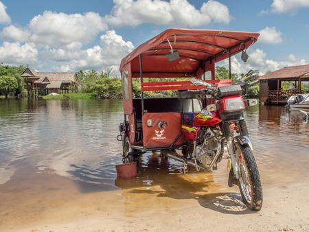 Santo Tomas, Peru - May 17, 2016: Rickshaw in the river in the small village Santo Tomas