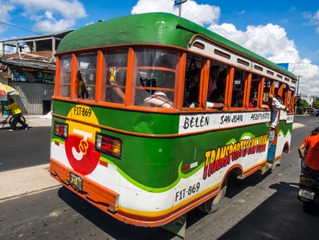 Iquitos, Peru  - May 17, 2016: Corolful bus on street of Iquitos