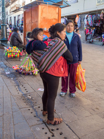 Cusco, Peru - May 18, 2016: Children from the school wearing the uniforms walking  on the street of the town. Stock fotó - 101461193