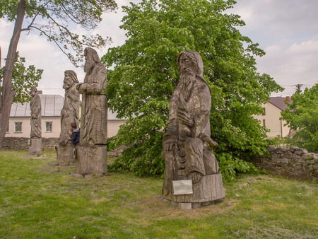 Wooden statues of different saints around the church of All Saints in Szydlow, Poland