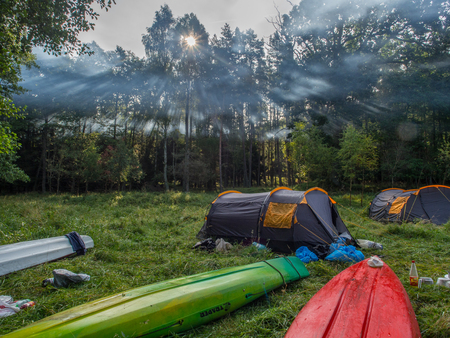 River Wieprza, Poland - August 24, 2017: Kayaks  and tents on the camping at a  bank of a the river Wieprza Editöryel