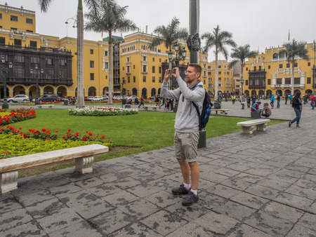 Lima, Peru - September 23, 2017: Tourist making a pictures on the Plaza de Armas Editorial