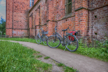 Brandenburg, Germany - June 10, 2017: Two bicycles on the background of the  Chorin Abbey (German - Kloster Chorin) in Brandenburg. Editorial