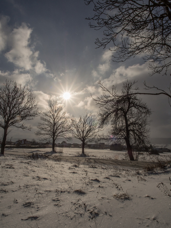 Hills covered with the white snow. Snowy winter in Poland. Stock Photo