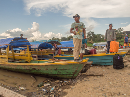 Tabatinga, Brazil - Dec 09, 2017: A Huge traffic of different types of boats and goods in the port of Amazon river, during the low water.