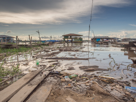 Tabatinga, Brazil - Dec 09, 2017: Pollution in the port of Amazon river, during the low water. Editorial