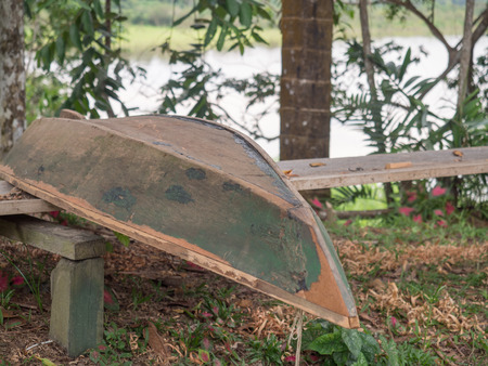 Traditional, Indian boat is building on the bank of the river in the Amazon jungle Фото со стока