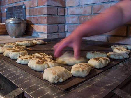 Pancakes on a baking sheet pepared on the  coal kitchen. Polish name: Blachorze, Brazioki. Poland.