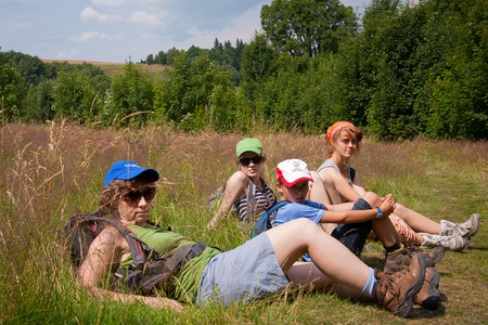 Mountain, Poland - July 21, 2014: Tourists are sitting and resting on the trail in the mountain.