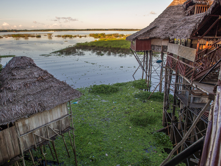 Houses on the flood plain of the Amazon river.  Iquitos, Peru