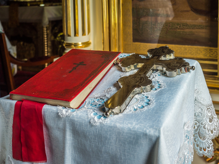 A silver cross and a bible in the orthodox church in Koterka. 報道画像