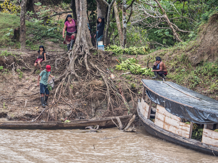 Amazon River, Peru - March 25, 2018:  Small village on the bank of the Amazon River