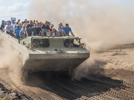 Borne Sulinowo, Poland - August 23, 2015: Military armoured vehicle takes tourists around the training ground