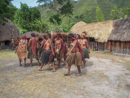 Wamena, Indonesia - January 23, 2015: Dani tribe women dancing in the front of their house Sajtókép
