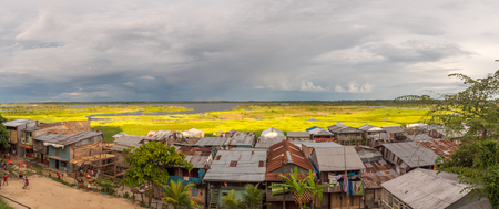 Sunset. Panoramic view of a floating houses and the Itaya river in poor district of Iquitos, Loreto, Peru.  Amazon