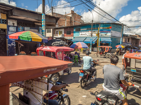 Iquitos, Peru- May 14, 2016: Various rickshaws on a  street of a small town. Editorial