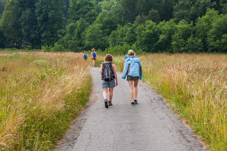 Young people on the mountain trail. Table mountains. Góry Stołowe, Poland.