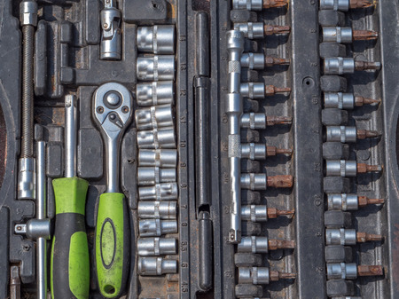 Set of ratchet sockets, socket wrenches, flat wrenches in a plastic, portable box. Stock Photo