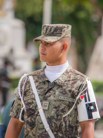 Iquitos, Peru - May 15, 2015: Peruvian soldier on Sunday morning  on the Plaza de Armas (Main square) in Iquitos. Редакционное