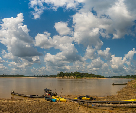Paumari, Brazil: - Sep 18, 2018: Wooden boats and kayaks on the bank of Yavari, the tributary of the Amazon river, in river during the low water season. Amazonia. Jungle on the border of Brazil and Peru. South America, Editorial