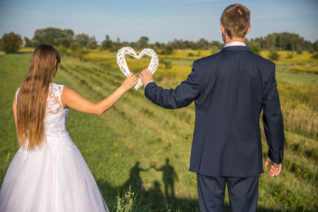 Just Married. Beautiful young couple with the white heart