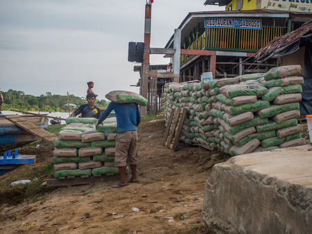Caballococha, Peru - Dec 11, 2017: Transhipment of goods in the port on the Amazon river on the way from Santa Rosa to Iquitos