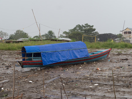 Tabatinga, Brazil - September 22, 2018:  Boat stuck on the bank of the Amazon river during low water season.