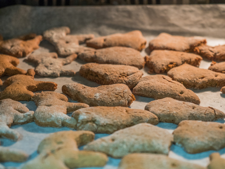 Gingerbreads are baking in the oven for Christmas