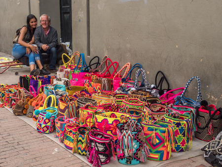 Bogota, Colombia - May 02, 2016: Colomboian people selling colorful bags on the street of Bogota. Colombia. Latin America.