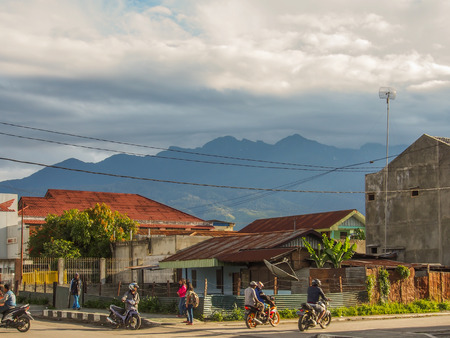 Wamena, Indonesia - January 22, 2015: Street of small village Wamena rouded with the mountain. West Papua.