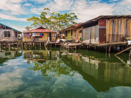 Jayapura, Indonesia - January 24, 2015: Stilt houses in Kampung Ayapo, Lake Sentani, Papua, Indonesia
