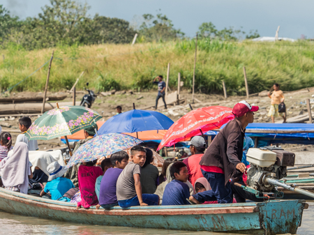 Tabatinga, Brazil - Sep 21, 2018: People on the boat from Ticuna tribe  (Magüta, Tucuna, Tikuna, or Tukuna]). They are an indigenous people of Brazil, Colombia and Peru. Most numerous tribe in the Brazilian Amazon