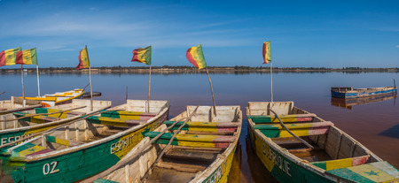 Lac Rose, SenegalL - Feb 02, 2019: Wooden boats on the coast of the Lake Retba. Panoramic view. Africa