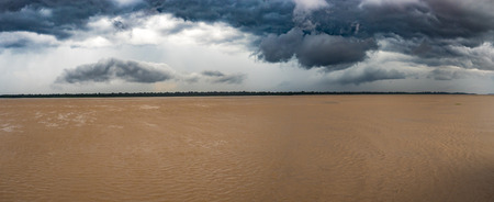 Panoramic view of Amazon River during stormy weather, White water. Amazonia.  Peru. South America.