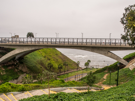 Lima, Peru - May 27, 2016: Bridge and stairs to the ocean in the Miraflores district, LIma, Peru,  South America