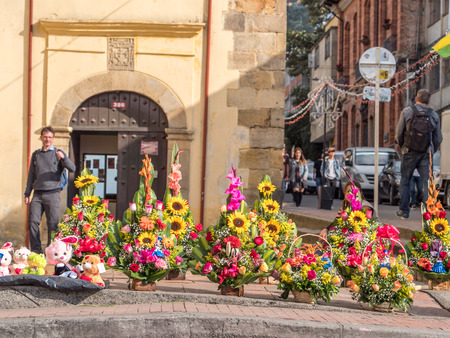 Bogota, Colombia - November 23, 2018: Baskets of colorful flowers on the street of Bogota. Colombia. Latin America.