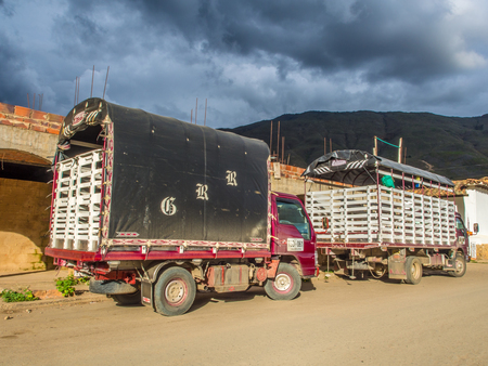 Villa de Leyva, Colombia  - May 03, 2016: Two truck on street of a small southern town. South America