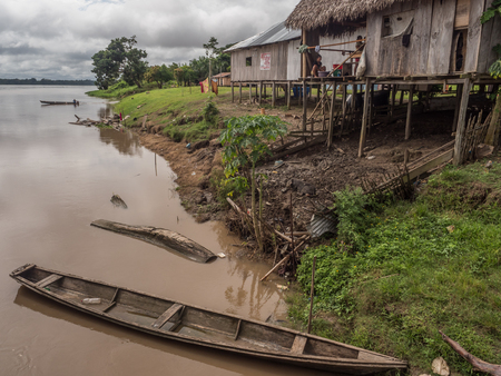 Amazon River, Peru - December 04 , 2018:  View of village on the bank of the Amazon River. South America.