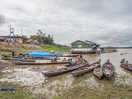 Tabatinga, Brazil - November 25, 2018: People in the  wooden boat in  the port of Amazon river. South America. Amazon River.  Tres fronteras. Rain Forest of Amazonia. Redakční
