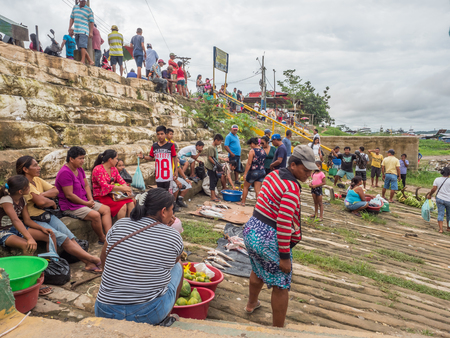 Tabatinga, Brazil - November 25, 2018: People on the local market in  the rainy day  in the port of Amazon river. South America. Amazon River.  Rain Forest of Amazonia.