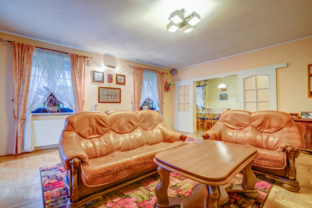 Furnished apartment. Living room with leather sofas, oak dining table and dining room.