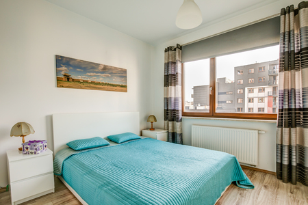 New furnished apartment. A bedroom with large windows and a nice view Reklamní fotografie