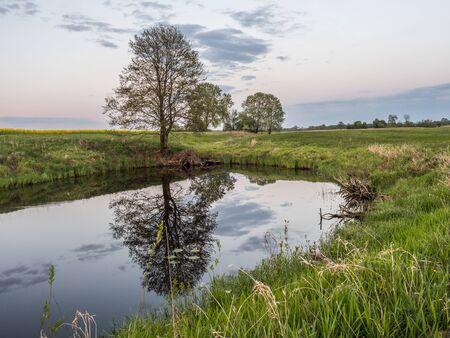 Sunset over the pond next to Bug river. Podlasie. Podlachia. Poland, Europe. The region is called Podlasko or Podlasze.